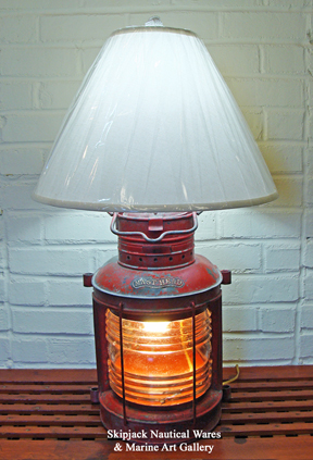 Authentic ship's masthead light re-purposed into a nautical table lamp.