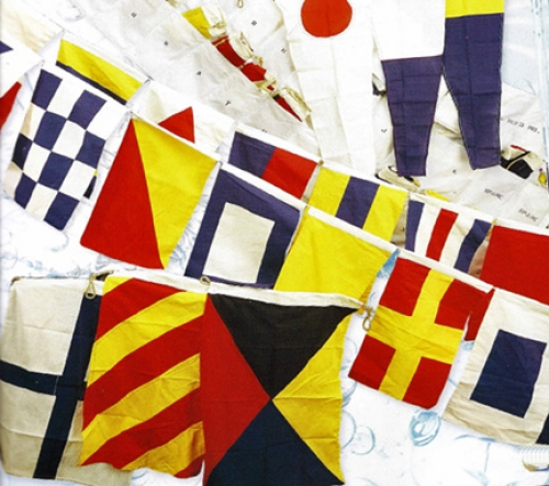 A line of 40 nautical flags measures a total over 50 feet in length. Each flag is made out of cotton