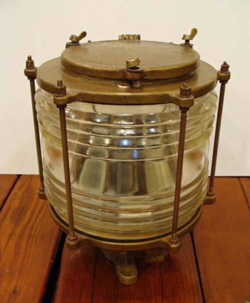 Solid cast brass vintage 360 degree ships masthead light. The glass Fresnel clear glass globe surviv