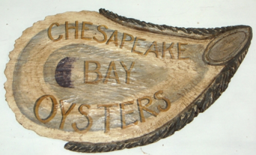 """Chesapeake Bay Oysters"" folk art carving by J & P Johnson -- length 40"""